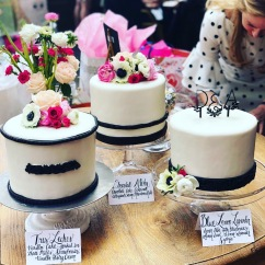 Fondant Finished Cake Finished with Custom Topper and Fresh Florals