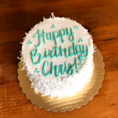 """Simple Decorated 8"""" Cake with Buttercream and Coconut Flakes"""